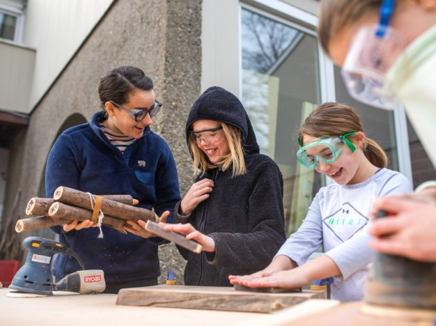 Students learning about woodworking.