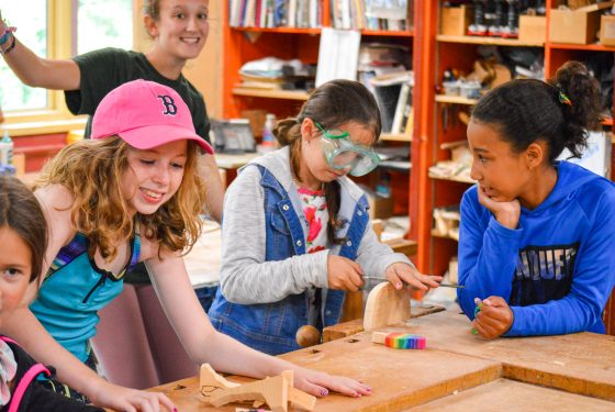 A group of campers working on crafts.