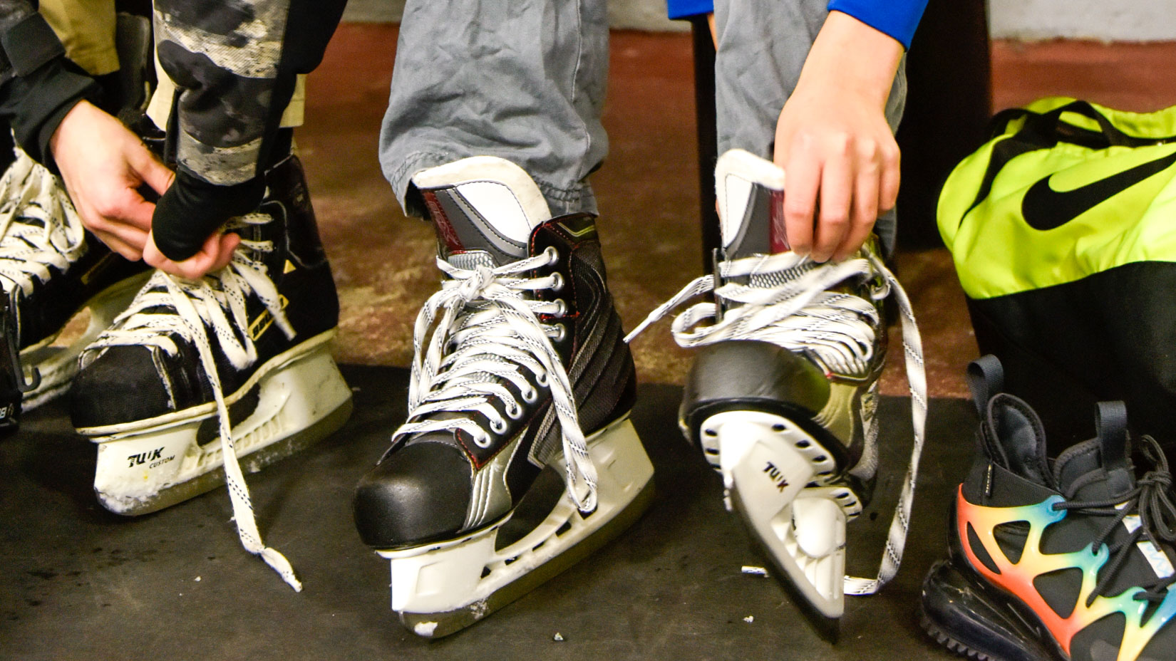Students tying up their skates.
