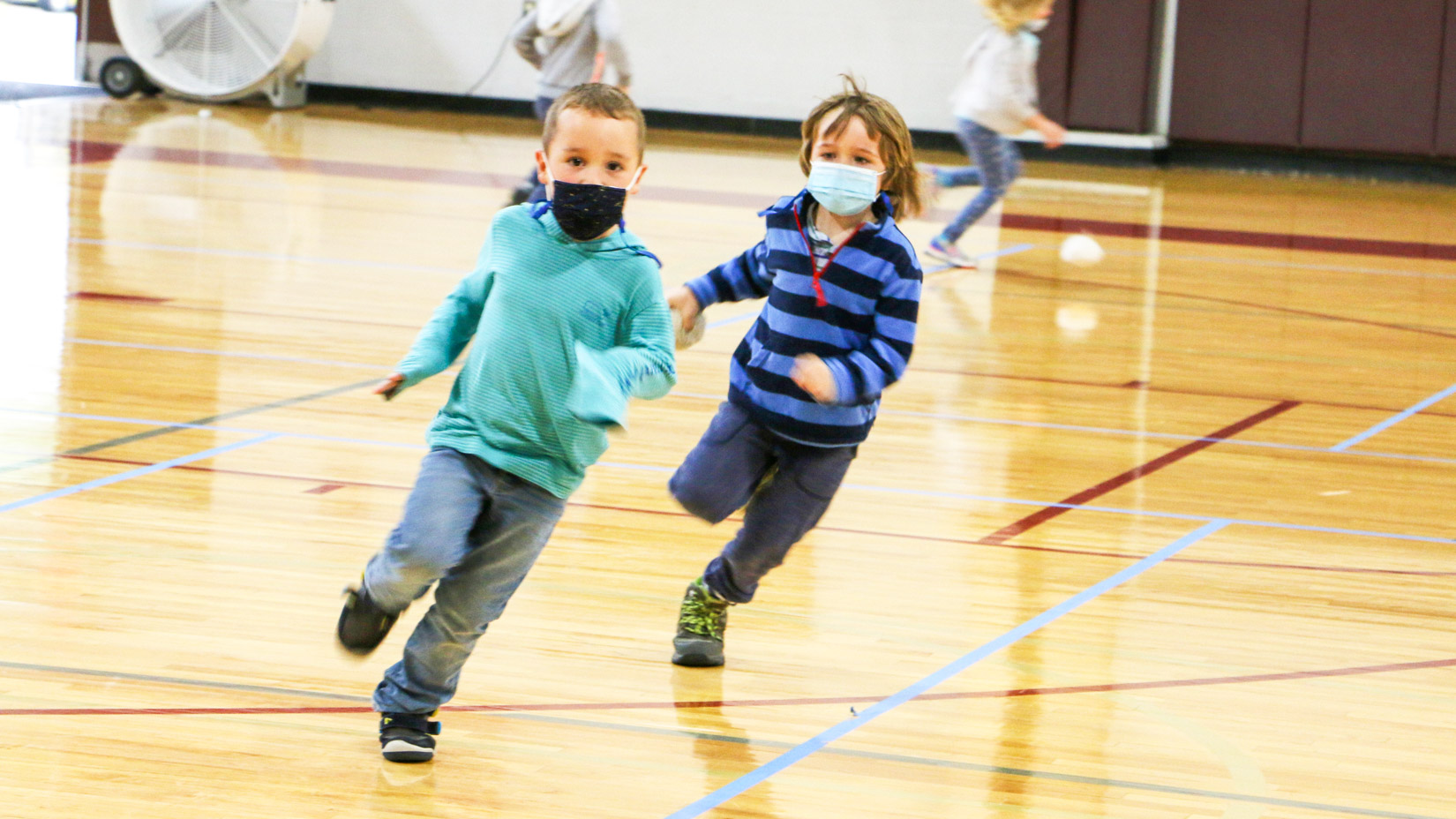 Students running in the gym.