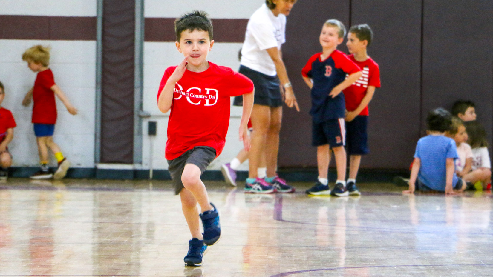 A student running in the gym.