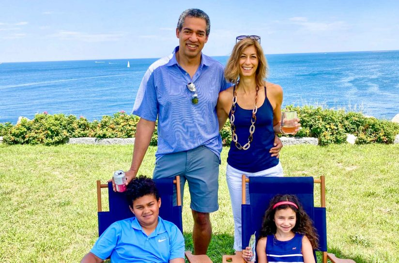Alyson Kelley-Hedgepeth and Chester Hedgepeth smiling with their children while at the coast.