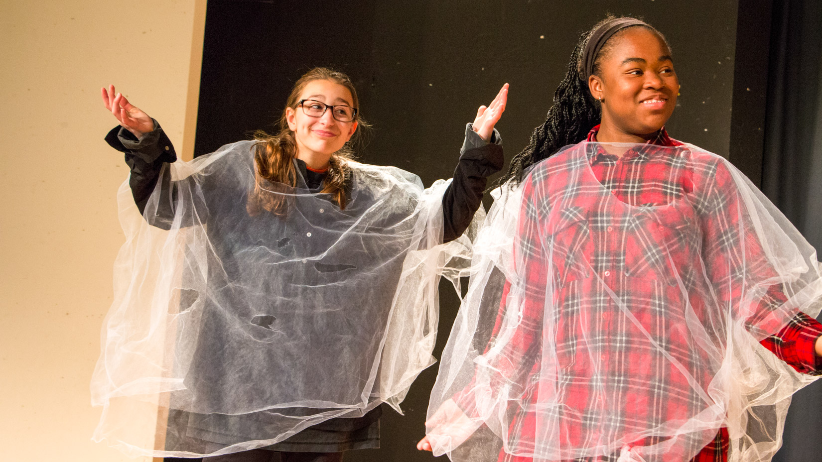 Two students performing a scene together.