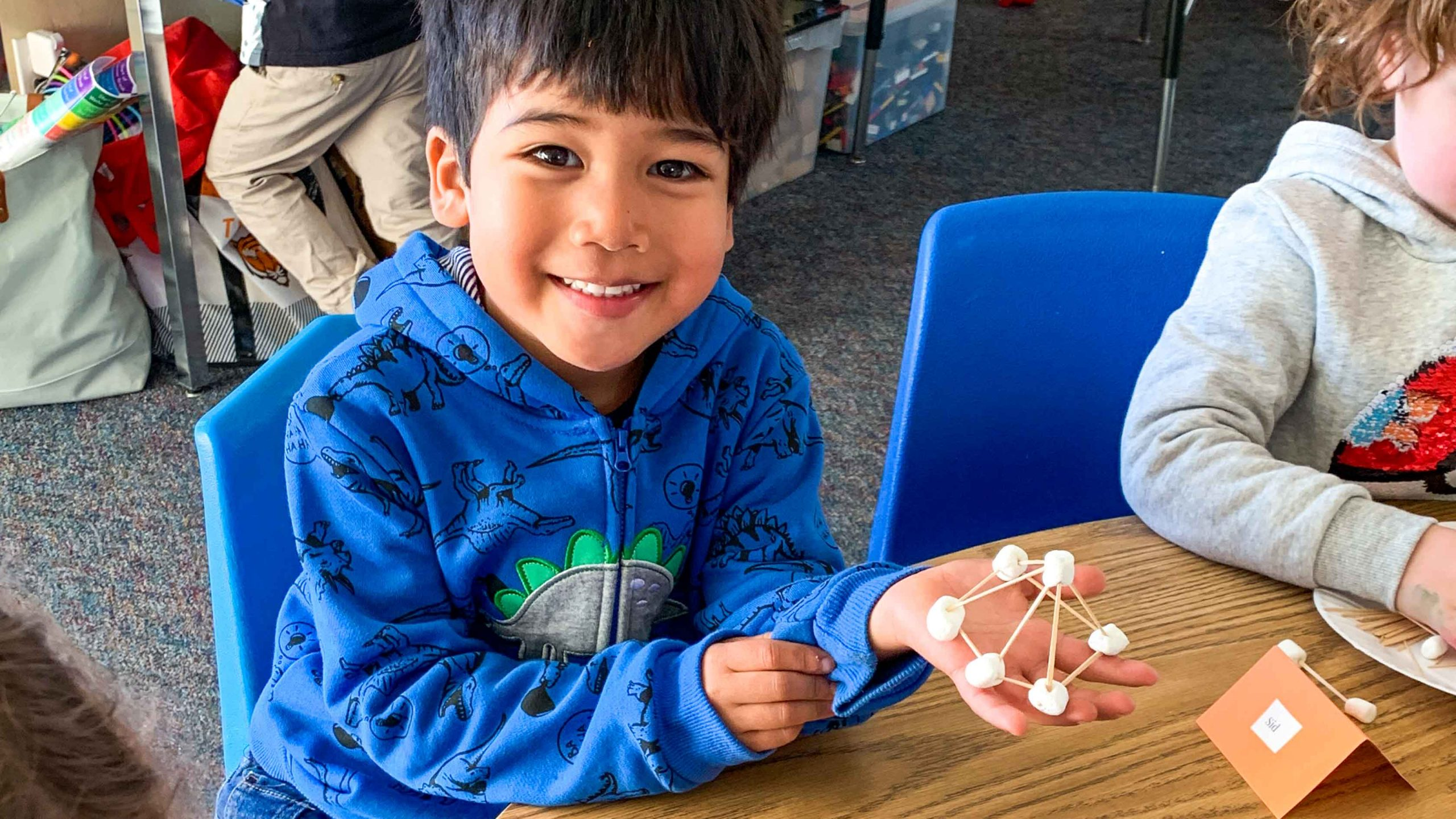 A student working on a crafting project in the extended day program.