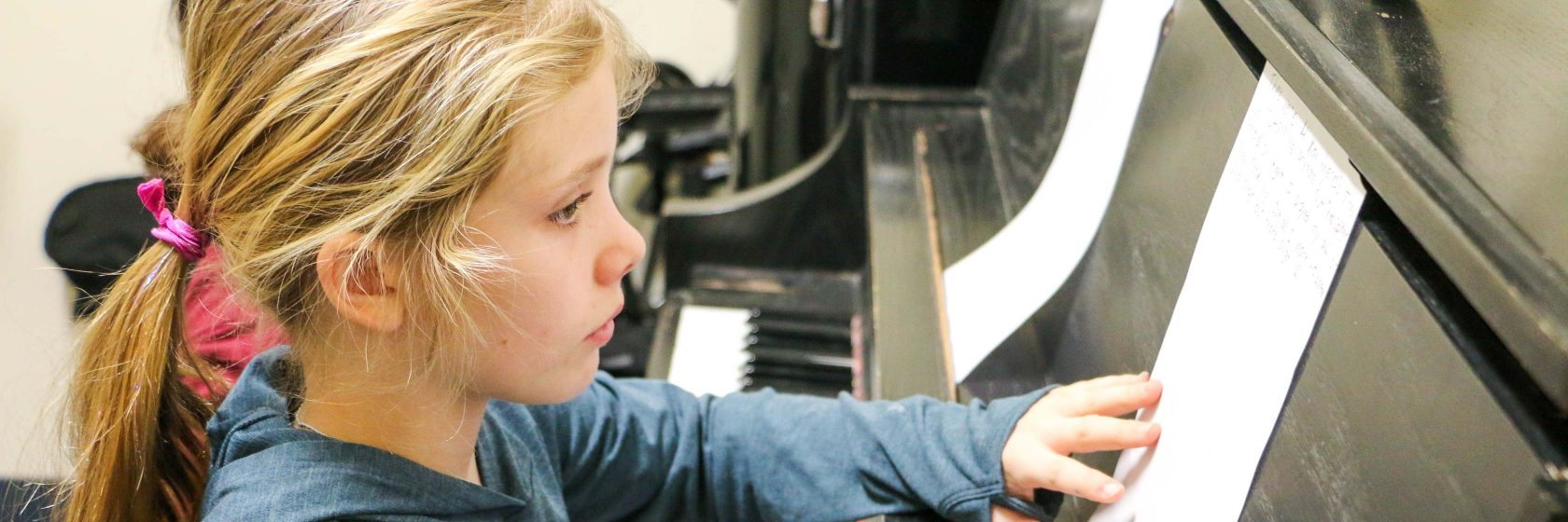A student working on learning the piano.
