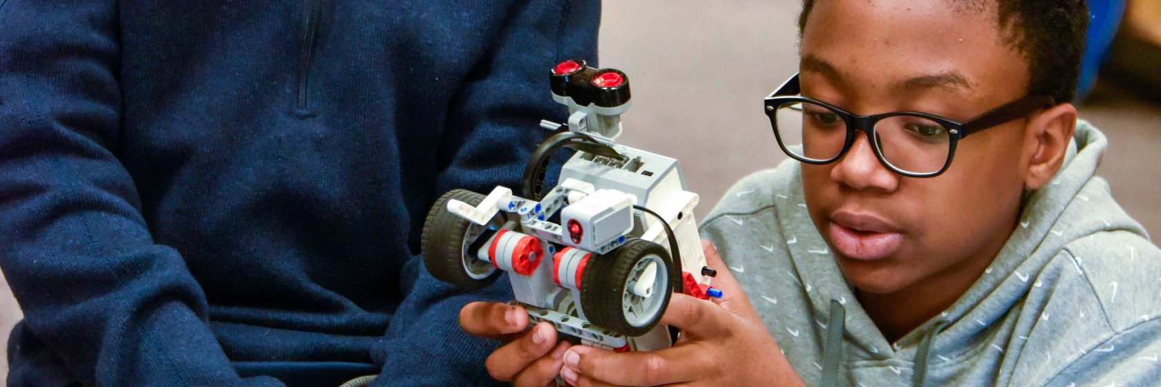 Students working on lego robotics.