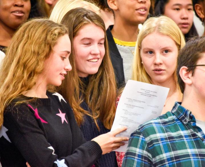 Alumni singing in a ceremony