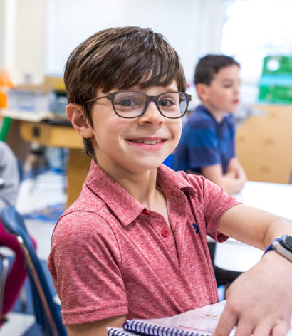 A student smiling at the camera.