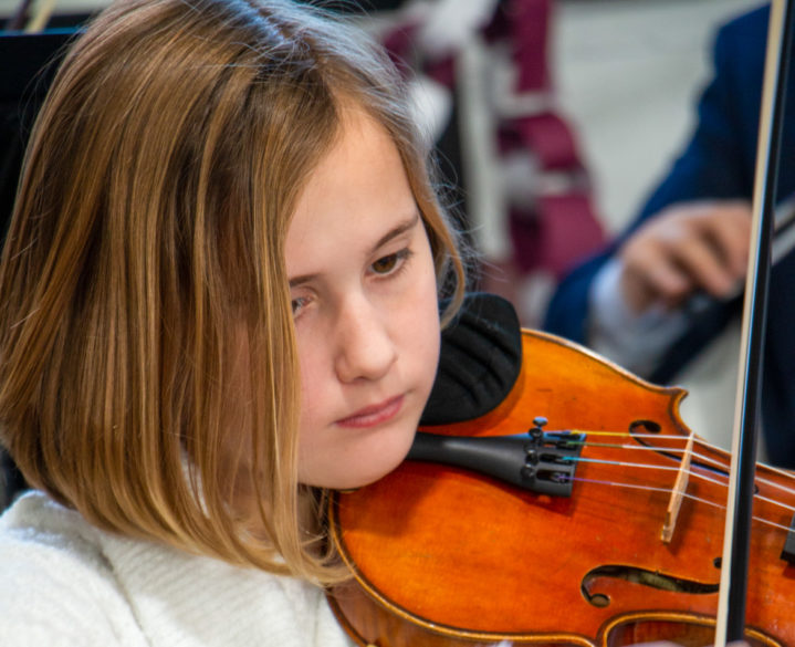 A student playing the violin