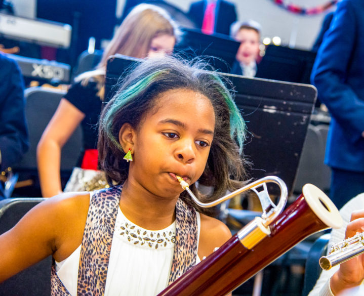 A student playing an instrument during a concert.