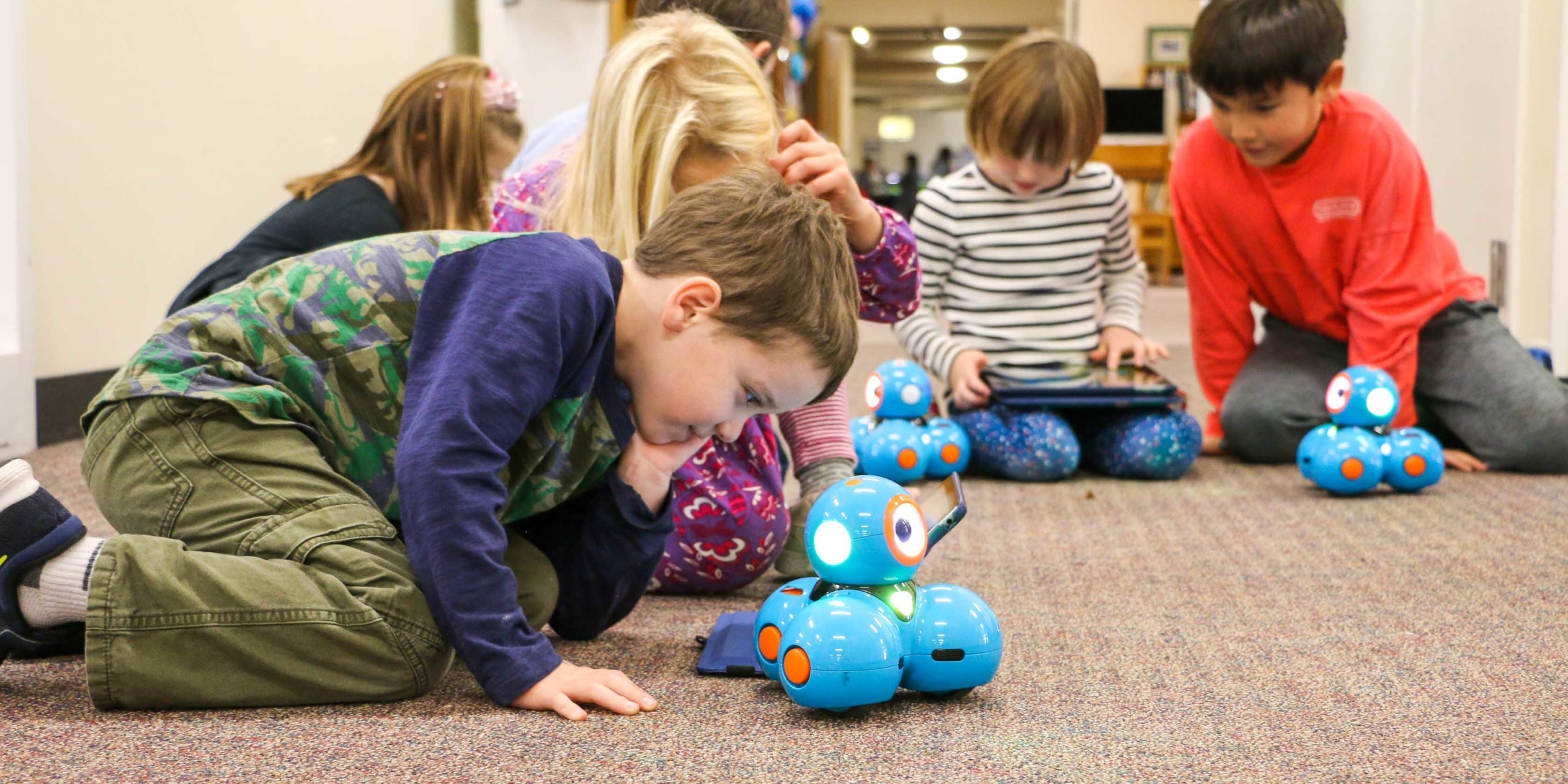 a student playing with a robotic toy
