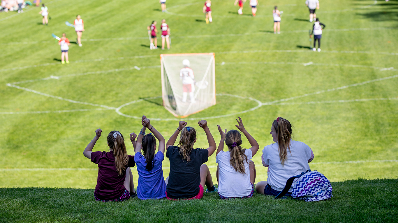 students watching lacrosse game