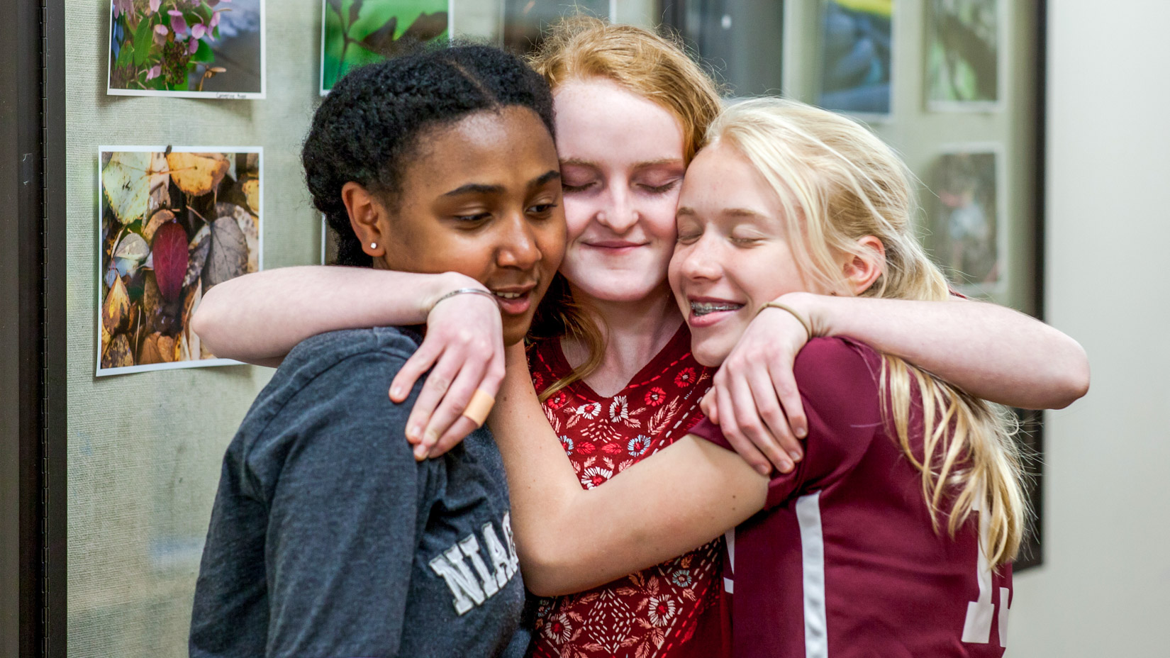 Students hugging and smiling